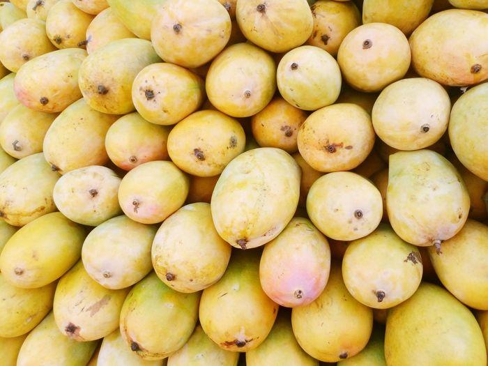 Full frame shot of mangoes at market stall