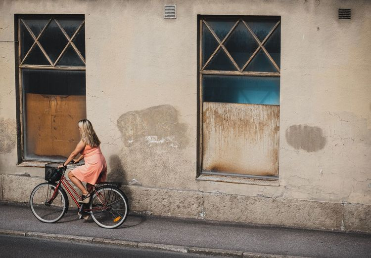 Sonyalpha Color Streetphotography Street Photography Bicycle Transportation Architecture Building Exterior City Built Structure Mode Of Transportation Street One Person Road Building Real People Outdoors Window Day
