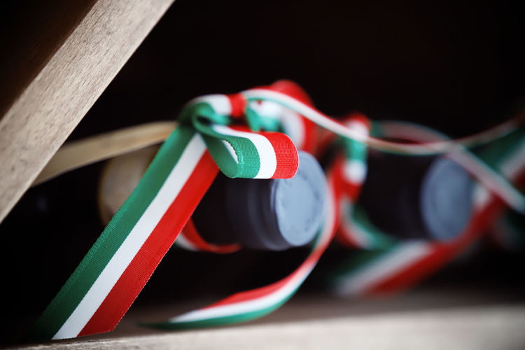 Patriotism Patriotic Italy Wine Bottle Loop Close-up No People Multi Colored Indoors  Cable Still Life Selective Focus Red Electricity  Focus On Foreground Table Green Color Wood - Material Choice Variation Connection Technology Equipment Black Background Music