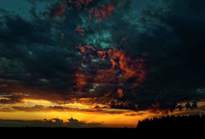Atmospheric Mood Beauty In Nature Claudetheen Cloud - Sky Dramatic Sky Landscape Low Angle View Nature Orange Color Silhouette Sky Storm Cloud Sunset Tranquil Scene Tranquility Tree Capture The Moment