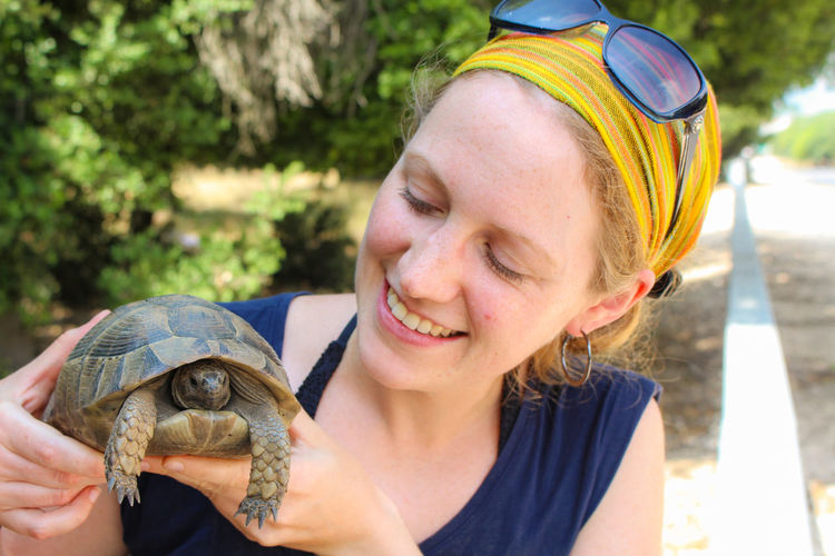 Happy Woman Animal Shell Animal Wildlife Animals In The Wild Blonde Hair Emotion European Woman Girl Headshot Holding Inspection One Animal One Person person Pet Owner Portrait Reptile Rescue Shell Smiling Tortoise Tortoise Shell Turtle Young Adult