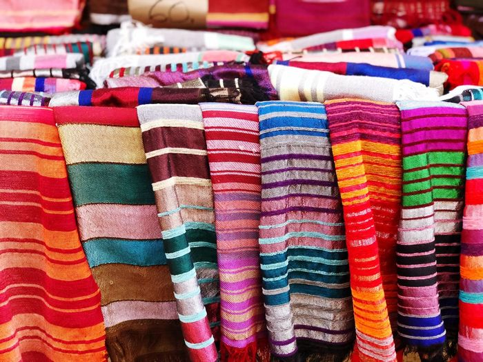 Full frame shot of multi colored textile for sale at market stall