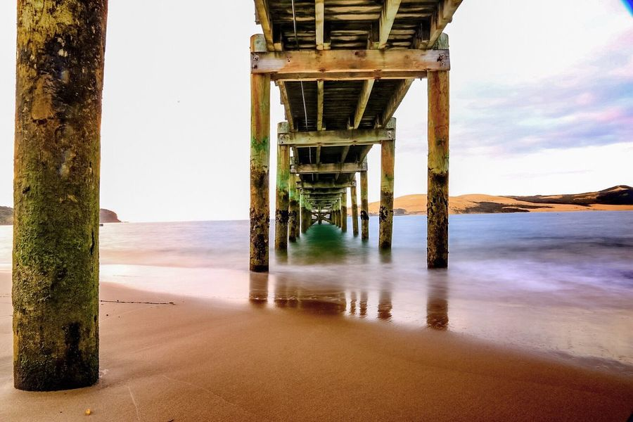 Water Sea Beach Nature Built Structure Beauty In Nature Day Tranquil Scene Architecture Tranquility No People Outdoors Sky Scenics Horizon Over Water Underneath Bridge - Man Made Structure Sunset Omapere New Zealand Scenery New Zealand Pier Coastline Clear Sky Beauty In Nature
