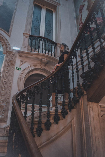 Architecture Built Structure One Person Real People Full Length Railing Staircase Building Standing Lifestyles Young Adult Building Exterior Leisure Activity Young Women Women Casual Clothing Front View Low Angle View Steps And Staircases