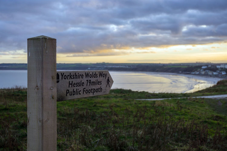 Wolds Way Sign, Filey, North Yorkshire - the start and end of the Wolds Way, Yorkshire UK Communication Water Cloud - Sky Sign Sunset Tranquility Scenics - Nature Tranquil Scene Beauty In Nature Outdoors Filey Filey Bay Wolds Way Wooden Sign
