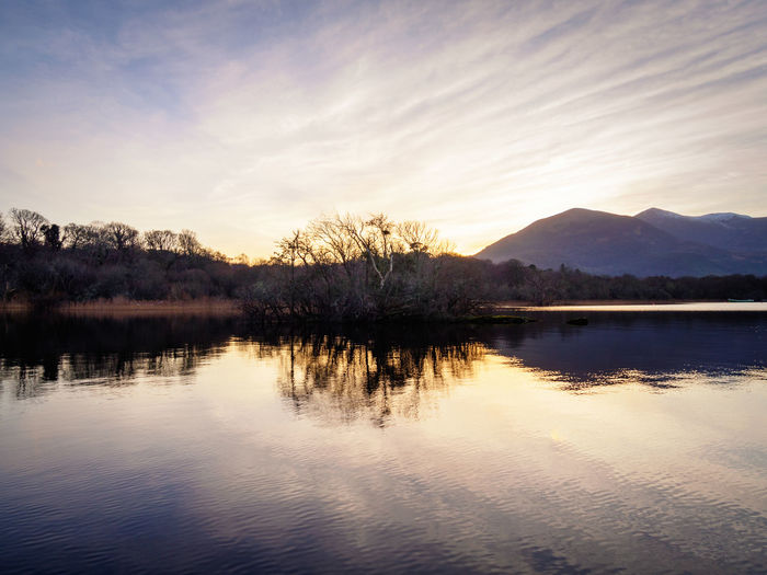 Lough Leane sunset 🌄 Ireland Killarney  Beauty In Nature Cloud - Sky Day Idyllic Lake Lough Leane Mountain Mountain Range Nature No People Outdoors Reflection Scenics Sky Sunset Tranquil Scene Tranquility Travel Destinations Tree Water Shades Of Winter
