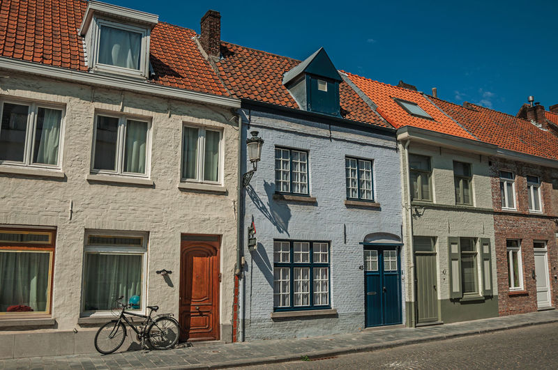 Facade of old houses in street of bruges. a town full of canals and old buildings in belgium.