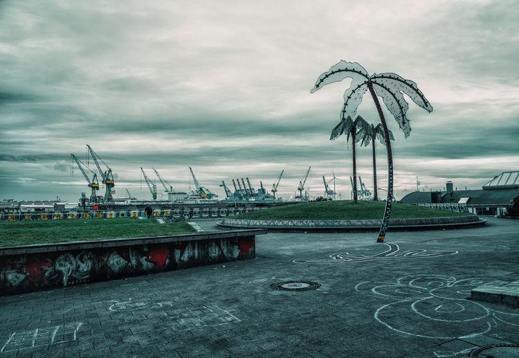 Ferris wheel in city against sky