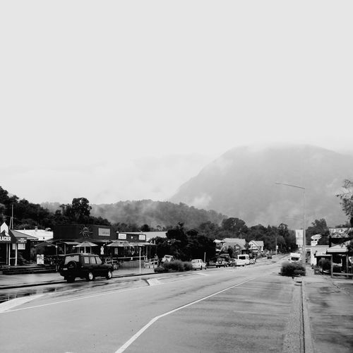 Foggy views from Fox Glacier town. Mountain Fog Monochrome Blackandwhite B&w Travel Destinations Tree Road Road Sign Car Sky Land Vehicle