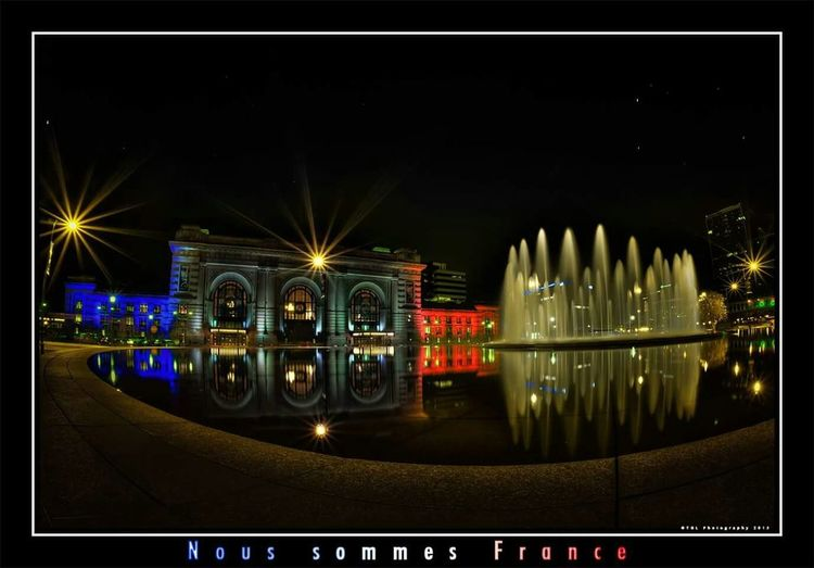 Union Station in Kansas City is lit in solidarity for France. Unionstation Kansascity Wearefrance France Nightphotography Architecture Fountain Citylights