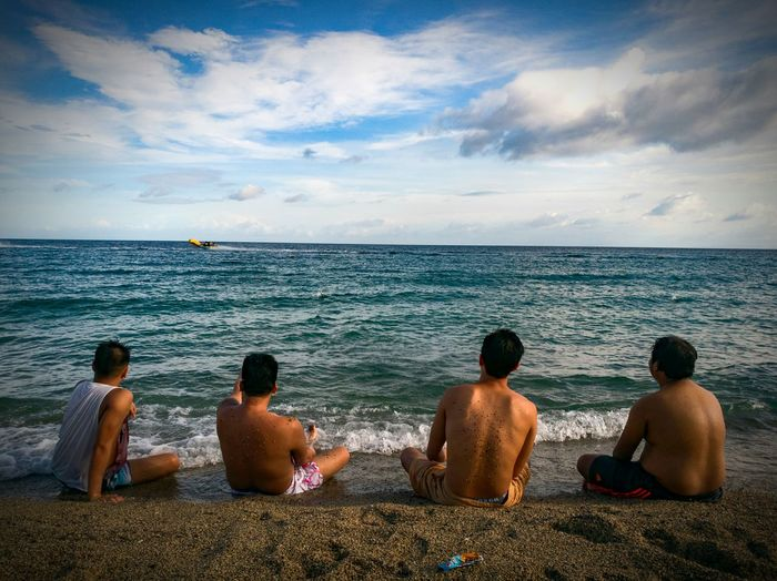 Sea Vacations Beach Rear View Horizon Over Water Relaxation Sky Travel Water Sand Travel Destinations Tourism Friendship Men Cloud - Sky Summer People Group Of People Tropical Climate Outdoors
