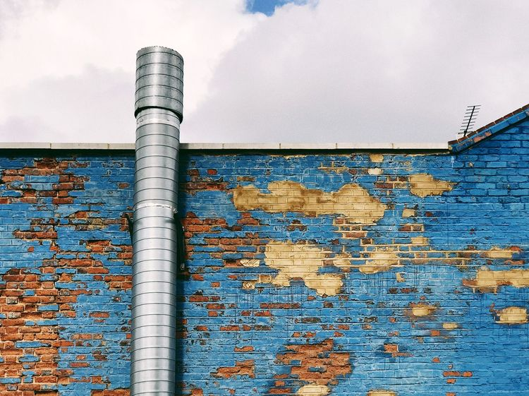 Rusty blue Shot On IPhone VSCO Architecture Blue Building Exterior Built Structure Close-up Cloud - Sky Corrugated Iron Day Factory IPhoneography Metal Mobilephotography No People Outdoors Paint Pipe - Tube Rusty Sky Vscocam Weathered