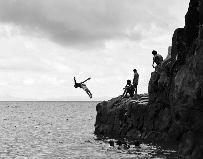 People Together While these kids were having fun swimming, I waited for someone to dive or make a flip, and made countless attempts just to capture this one perfect moment. Taking Photos From My Point Of View Fresh On Market July 2016 Eyeem Market Eyeem Philippines Diving Children Kids Fun Swimming Bnw Eyeem Philippines Album Kids Having Fun Kids Playing Landscape Seascape Showcase July EyeEm Best Shots - Black + White The Great Outdoors - 2016 EyeEm Awards Canon_photos Canonphotography Canon EyeEm Best Shots Bnwmood