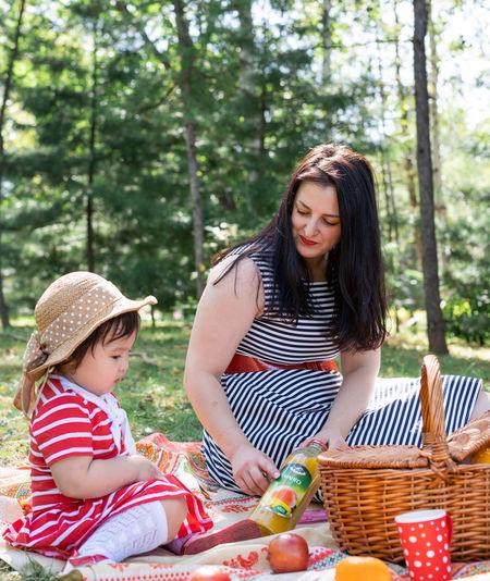 Happy girl sitting on wicker basket