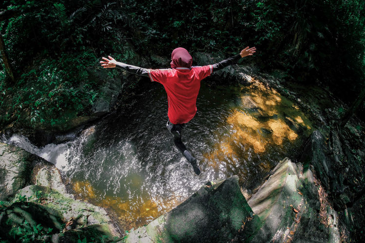 Sungai Pisang Rainforest Hike Fish Eye Lens Woman In Hijab Adventure Arms Outstretched Arms Raised Beauty In Nature Excitement Flowing Water Forest Human Arm Jumping Leisure Activity Nature Outdoors Rainforest River Rock Rock - Object Tree Water Water Flowing Waterfall Visual Creativity Summer Exploratorium The Great Outdoors - 2018 EyeEm Awards