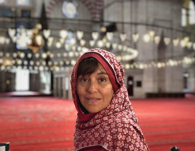 Portrait of smiling woman in mosque