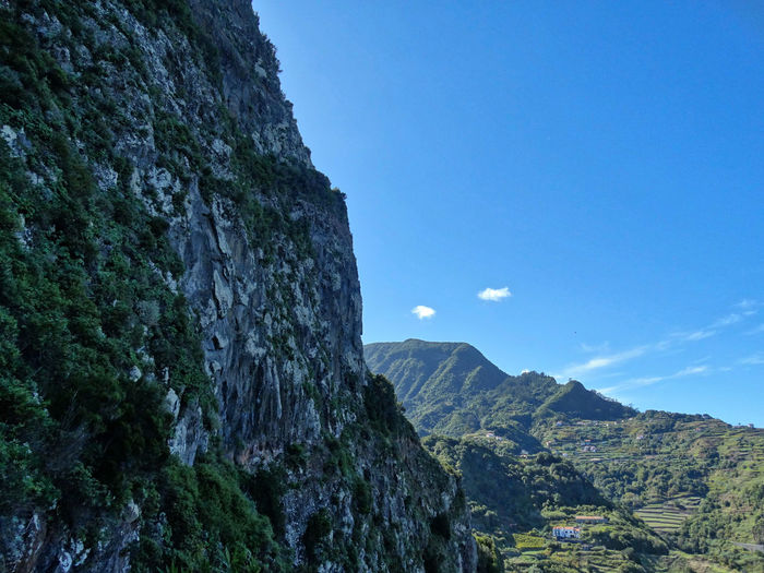 Scenery near Sao Jorge, Madeira. Mountain Sky Rock Nature Beauty In Nature No People Day Scenics - Nature Clear Sky Tranquility Land Landscape Low Angle View Tranquil Scene Environment Blue Outdoors Tree Rock - Object Mountain Range Formation Mountain Peak