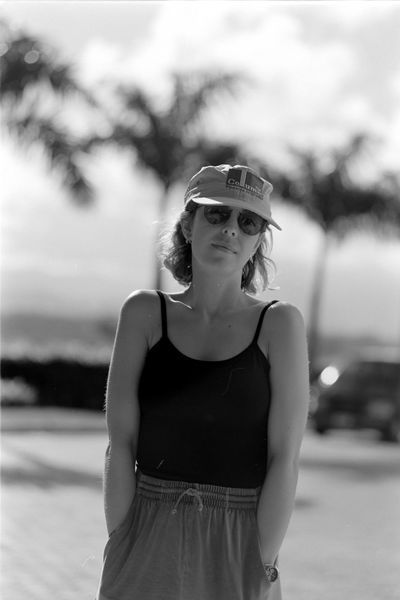 Alyssa in Cap Young Adult Lifestyles Fashion Sunglasses Portrait Glasses Standing Day Waist Up