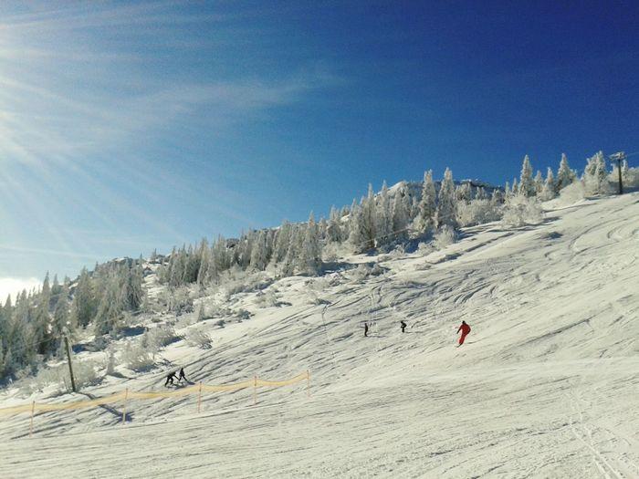 People skiing on mountain slope