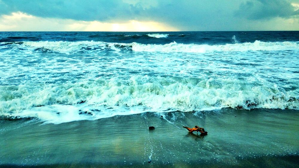Even the small could withstand these huge waves. Ocean Colours Of Nature Colour Of Life Colours Dawn Of A New Day Dawn Outdoors Landscape Nature Sky Beauty Surreal Scenics Sunrise Beauty In Nature Waves Aloof EyeEmNewHere