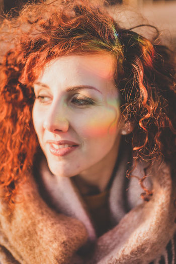 Close-Up Of Redhead Woman In Warm Clothing