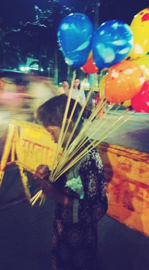 The hunger for love is much more difficult to remove than the hunger of bread - mother Teresa. EyeEmNewHere Multi Colored Night Balloons🎈 Children Photography Streetphotography Streetsofindia👣 Happiness Realhappiness Hunger Lovelovelove Giveasmile Nightlife Smartphonephotography