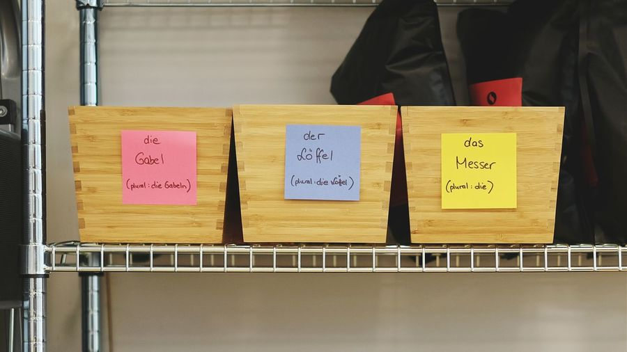 Close-Up Of Sticky Notes On Wooden Boards