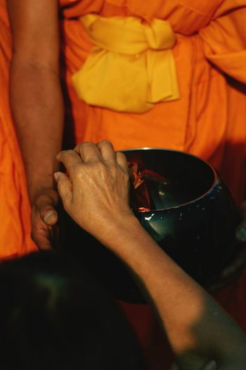 Midsection of monks during traditional festival