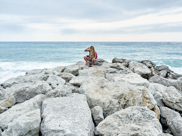 Capo d'Orlando sea Capo D'Orlando Sicily Beauty In Nature Day Girl Hairstyle Horizon Horizon Over Water Italy Land Leisure Activity Lifestyles Messina Nature One Person Outdoors Real People Rock Rock - Object Scenics - Nature Sea Sitting Sky Solid Water