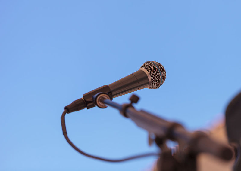 A music microphone against a blue sky in the summer at an outdoor concert Blue Sky Concert Microphone Music Outdoor Music Perform Sing Singer