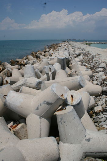 Crushers wave In Batam, Indonesia Abundance Beauty In Nature Blue Cloud Cloud - Sky Coastline Day Horizon Over Water Idyllic Nature No People Outdoors Pebble Remote Rock - Object Scenics Sea Shore Sky Stone Stone - Object Tranquil Scene Tranquility Travel Destinations Water