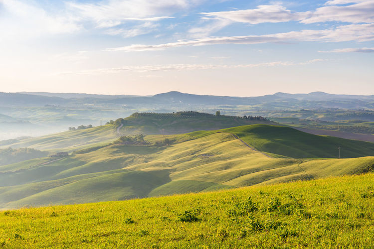 Rolling rural landscape view with morning mists in the valley
