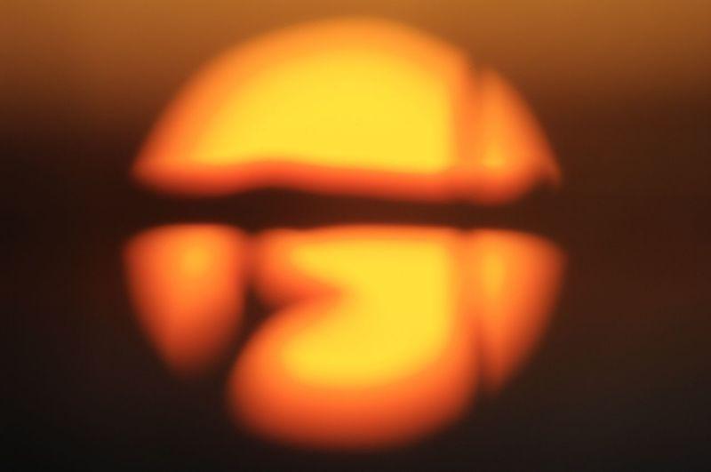 Close-up of illuminated pumpkin against black background