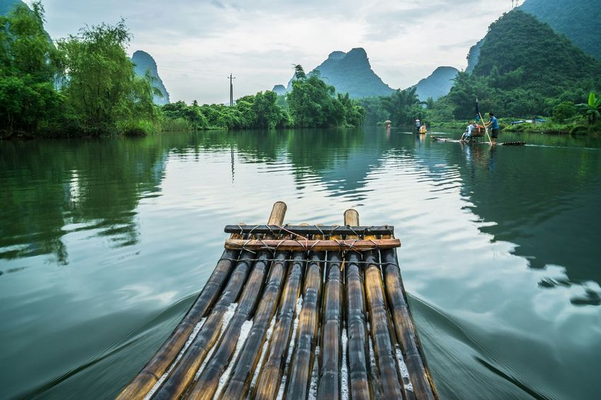 Lets move. A journey with Bamboo raft on Li River, Guilin, Yangshou, China Bamboo River Yangshuo Mountains Rafting Beauty In Nature Reflection The Traveler - 2015 EyeEm Awards Travel Destinations Li River The Week On EyeEm Feel The Journey Fine Art Photography Hidden Gems  Color Of Life Lost In The Landscape