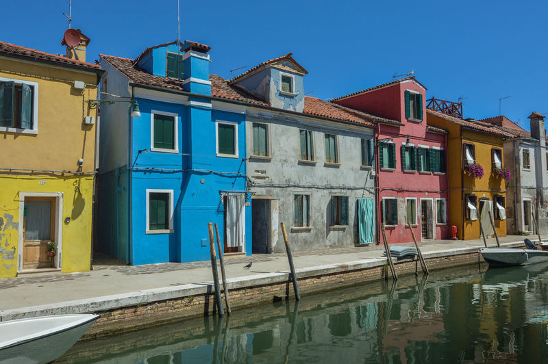Italia Architecture Blue Boat Building Exterior Built Structure Burano Clear Sky Color Day Italy Nautical Vessel No People Outdoors Reflection Sky Transportation Venice Water Waterfront Window