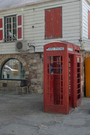Antigua red telephone booth Antigua Antigua And Barbuda Barbuda Caribbean Island Caribbean Sea Red Telephone Booth Travel Architecture Brick Brick Wall Building Building Exterior Built Structure Caribbean City Communication Connection Day Door No People Outdoors Pay Phone Red Street Telephone Telephone Booth Text Western Script