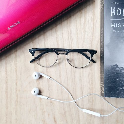 Lay Down Items Glasses Book Laptop Earpods No People