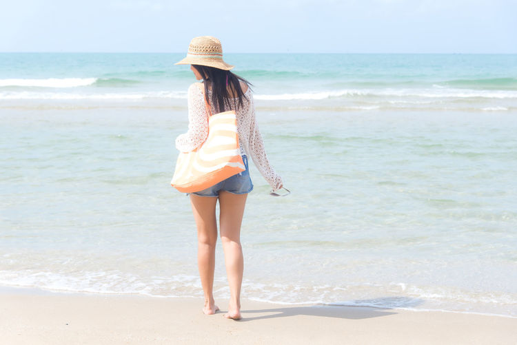 Beach Sea Land Water One Person Leisure Activity Real People Beauty In Nature Full Length Horizon Over Water Lifestyles Horizon Nature Standing Day Clothing Sand Sky Beautiful Woman Outdoors Sun Hat Hairstyle Summer Vocation Fashion Women Relaxing Freedom