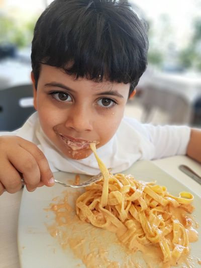 Close-up portrait of boy holding food