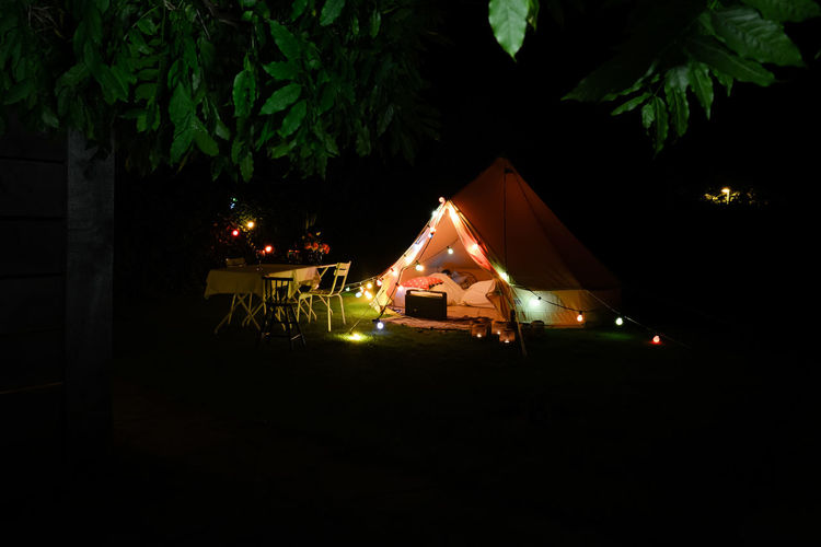 Decorated tent in a private garden. Asleep Atmosphere Bell Tent Camping Decorative Family Holiday Family Time Garden Glamping Illuminated Lights Lights In The Dark Luxury Nature Night No People Outdoors Outside Private Silence Sleeping Summer Tent Tree
