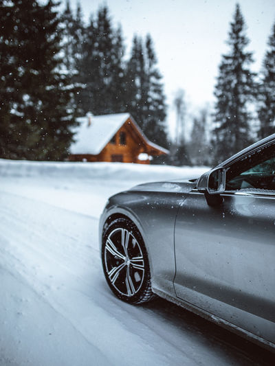 Winter Snow Cold Temperature Focus On Foreground Nature Tree No People Transportation Architecture Car Luxury Snowing Close-up Building Exterior Wood - Material Motor Vehicle Mode Of Transportation Day Outdoors Tree Forest Road Transportation Travel Beauty In Nature