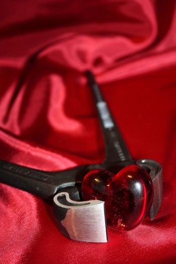 Pincers SymbolicArt The Still Life Photographer - 2018 EyeEm Awards Close-up Gripper Heart Heart Shape Indoors  Iron - Metal Love No People Positive Emotion Red Still Life Studio Shot Textile Tong
