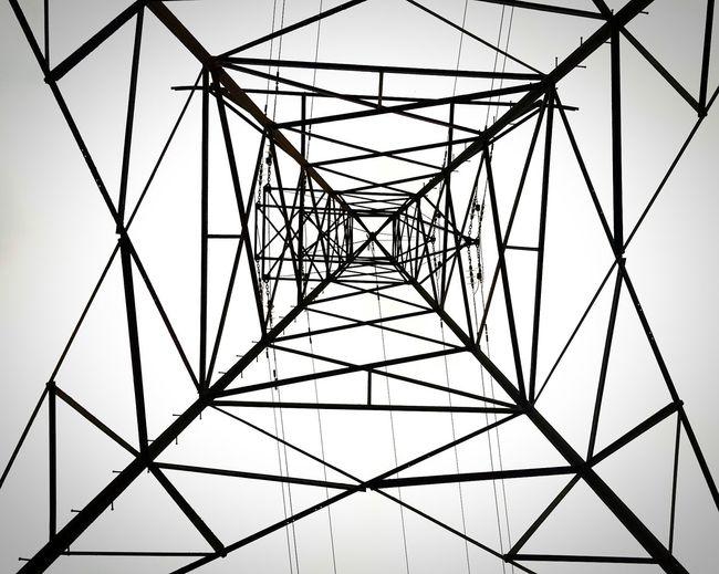 Full frame shot of electricity pylon against clear sky