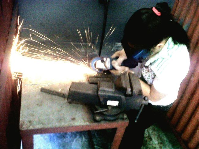 Ladygutt grinding flat bars during my welding course.