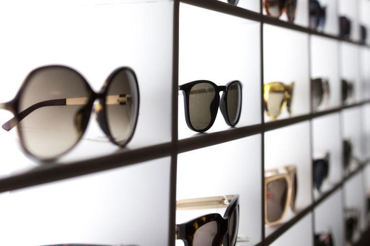 Full frame shot of sunglasses on shelf at store