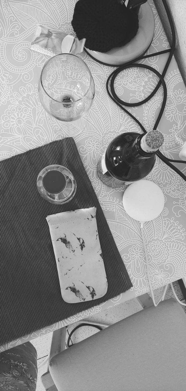 table, high angle view, still life, indoors, no people, glasses, close-up, food and drink, group of objects, kitchen utensil, group, fashion, household equipment, food, bowl, pattern, scissors, eating utensil, spoon, choice, floral pattern