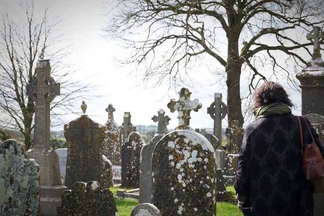 Always remember... Resist EyeEm Diversity Tombstone Cemetery Memorial The Past Spirituality Tree Rear View Bare Tree Graveyard Outdoors Women Gravestone Day People Celtic Cross Ireland