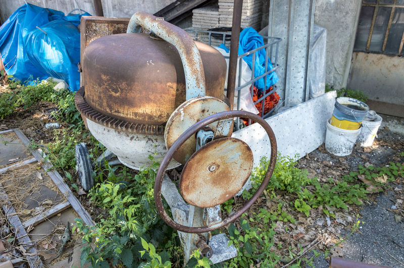 Construction site, cement mixer, equipment for bricklayer Abandoned Bad Condition Close-up Container Damaged Day Decline Deterioration Field High Angle View Land Metal Music Nature No People Obsolete Old Outdoors Run-down Rusty