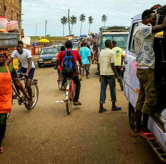 Everyday Life in Cape Coast Elmina,Ghana . Bike Riding, Street Activity , Street Photography West Africa .