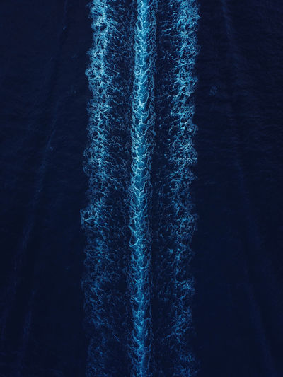Abstract aerial view of a boat wake pattern